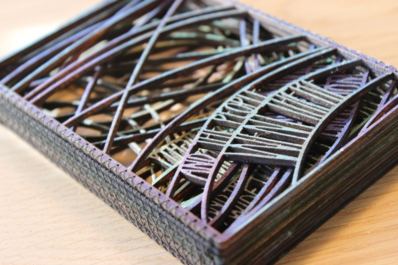 Laser cut book art by Emily Longbrake