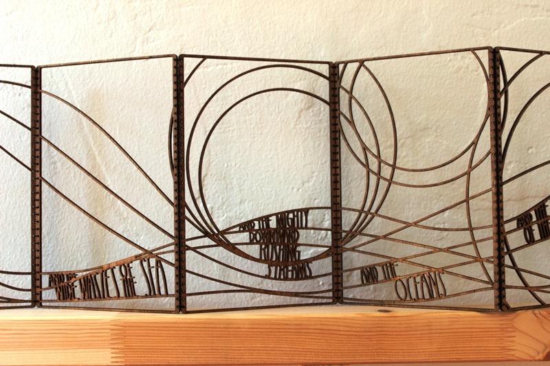 Laser cut book art by Emily Longbrake