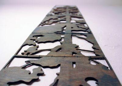 Douglas fir laser cut book by Emily Longbrake